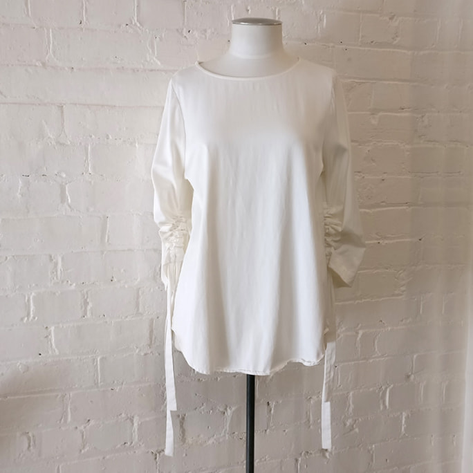Winter white crew top with gathered sleeves.