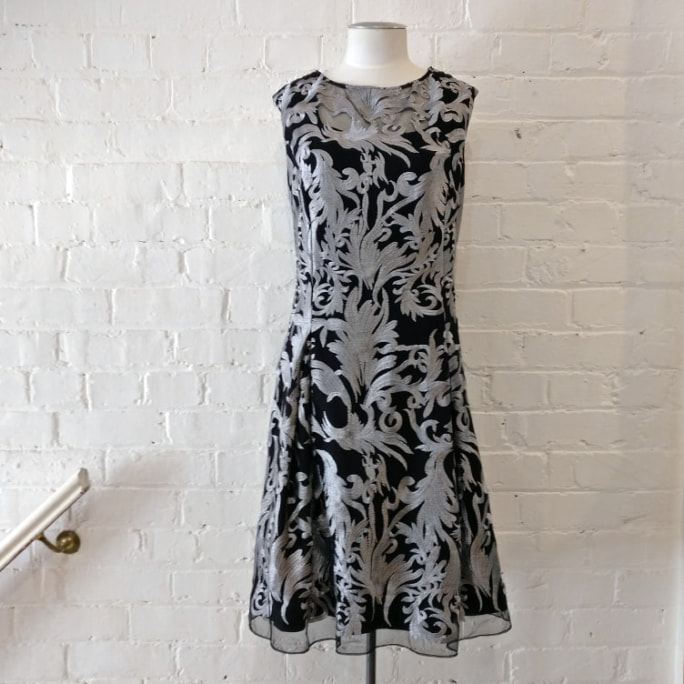 Sleeveless black dress with silver embroidery, fully lined.
