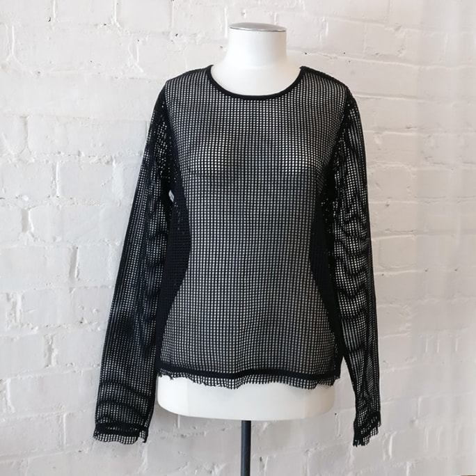 Long sleeve fishnet top.