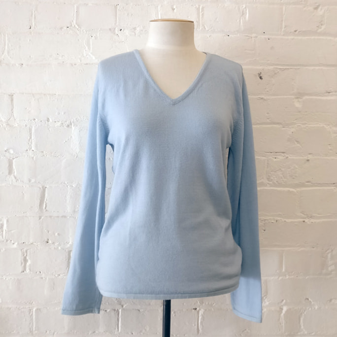 100% merino v-neck sweater. Unworn!