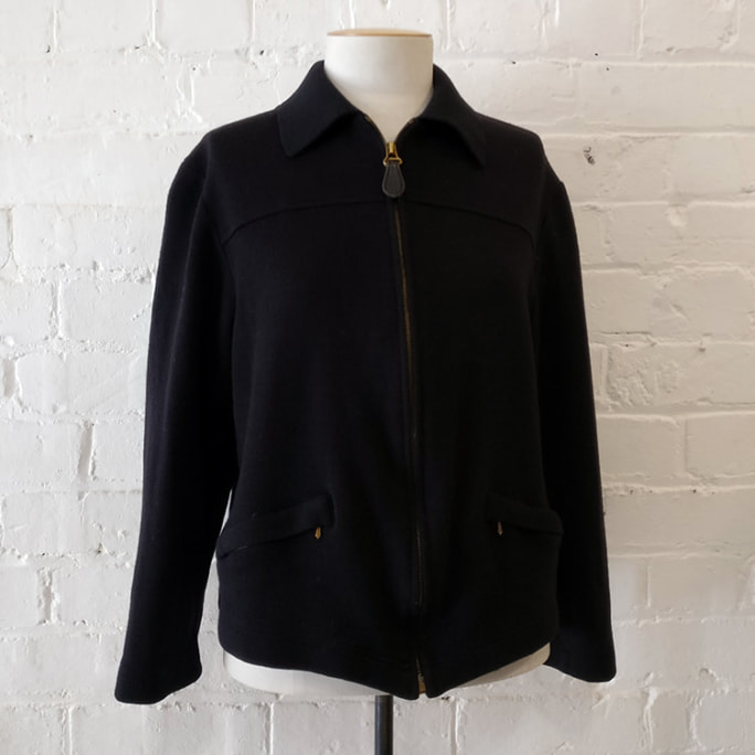 Woollen zip jacket with pockets, unlined.