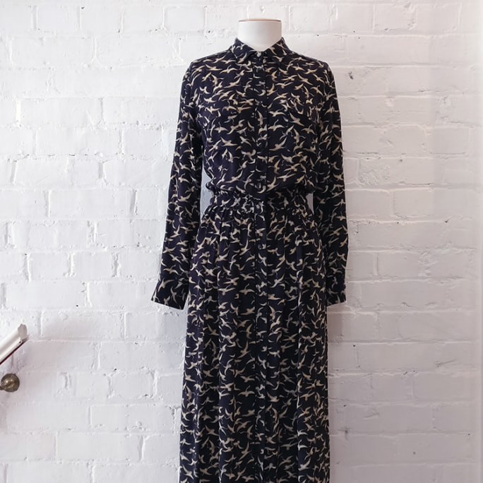 Printed silk shirt dress with side and breast pockets, unlined.