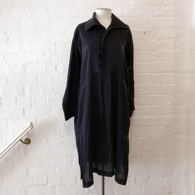 Black shirt dress with pockets.