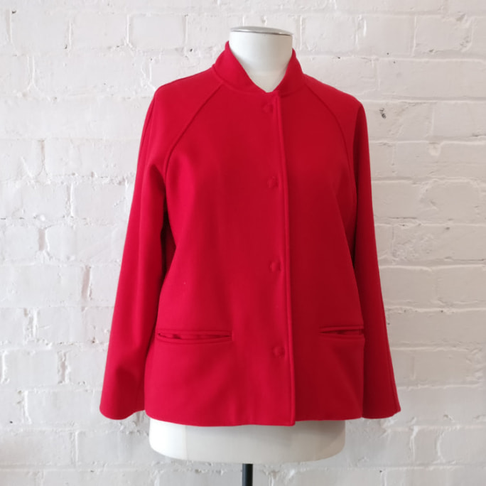 Collarless jacket with pockets, fully lined.