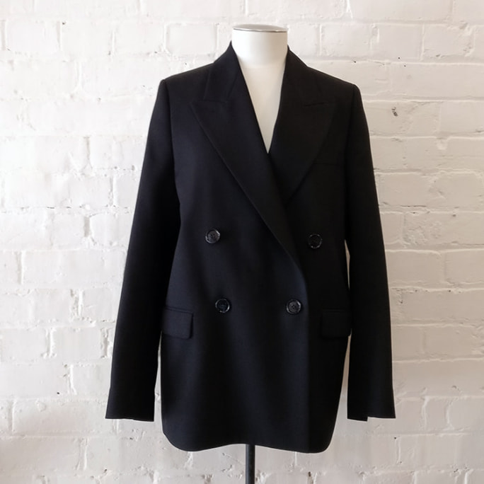 Double-breasted jacket with tuxedo lapels, lined.