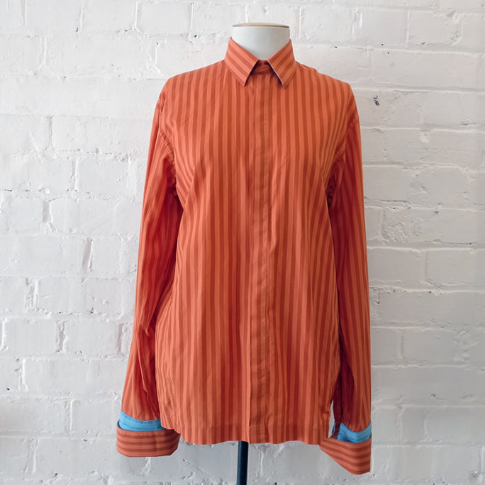Orange stripe shirt with contrast blue cuffs.