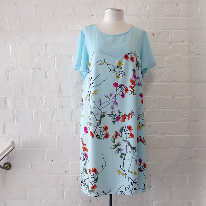 Floral dress with sheer bodice, fully lined.
