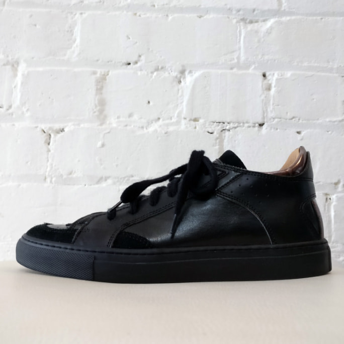 Leather sneakers with suede trim.