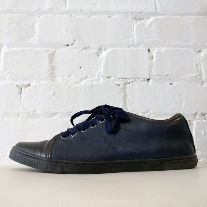 Blue leather slip-on sneakers with grosgrain lacing.