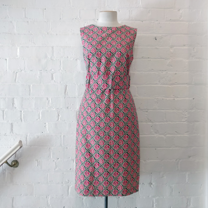 Floral cotton sleeveless shift dress, fully lined.