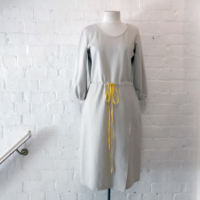 Drawstring waist easy-care dress, with pockets.