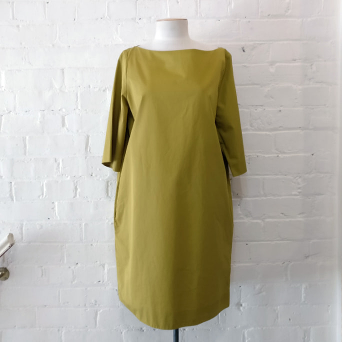 Boat neck tunic dress with side pockets.