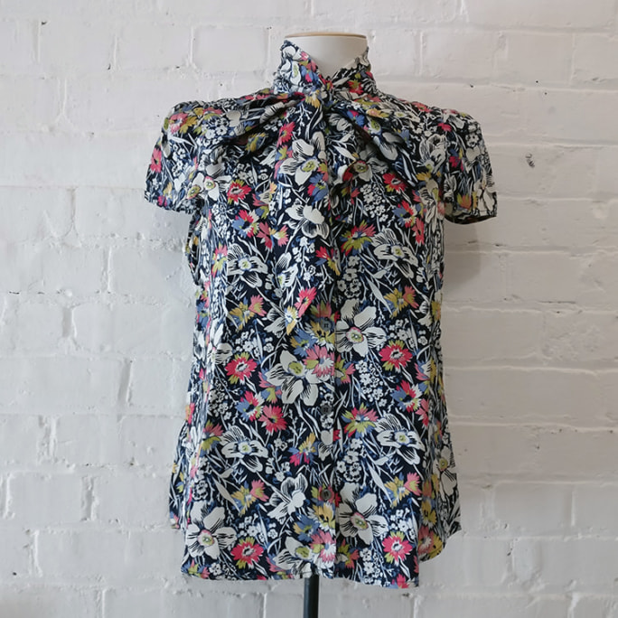 Cap sleeve silk floral blouse.