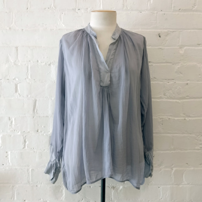 Collarless cotton/silk blouse.