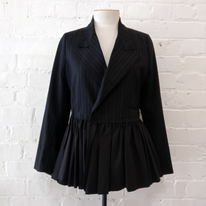 Structured jacket with frill hem.