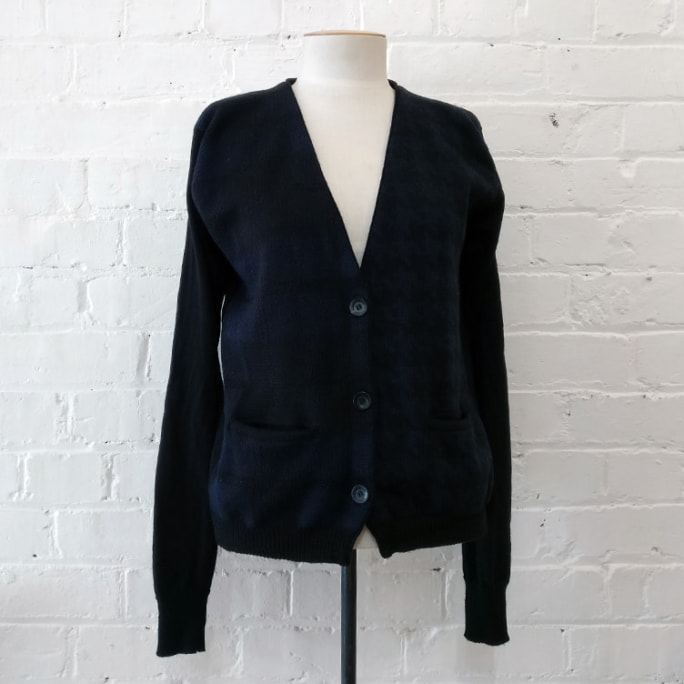 Black and blue woven merino cardigan with pockets.