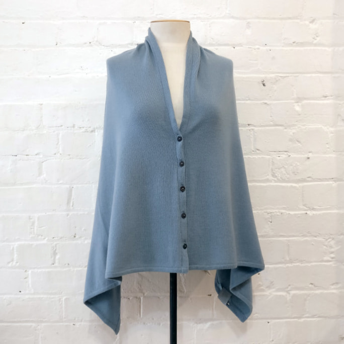 Button-up cashmere poncho.