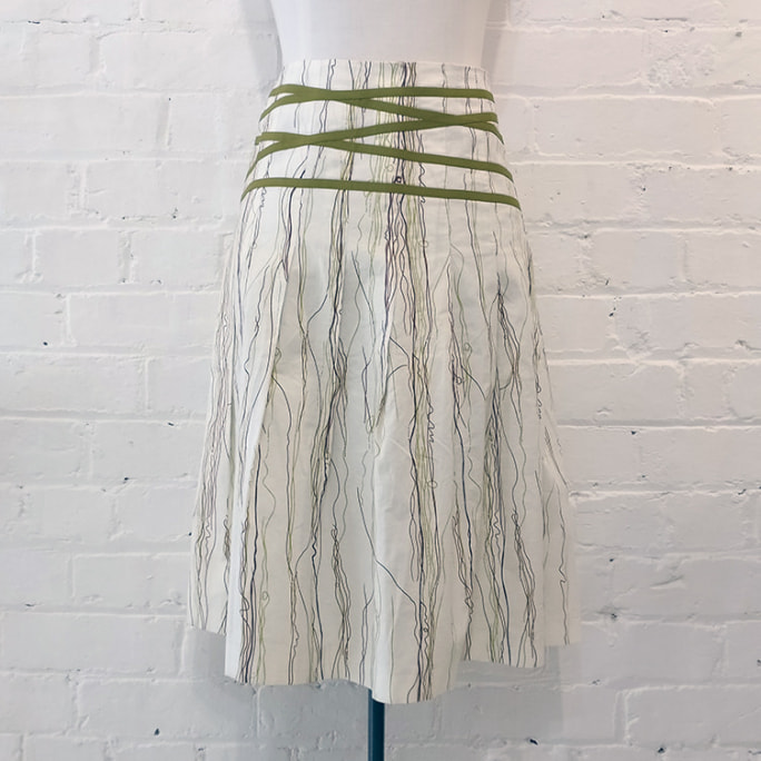 Flared cotton skirt with ribbon detail.