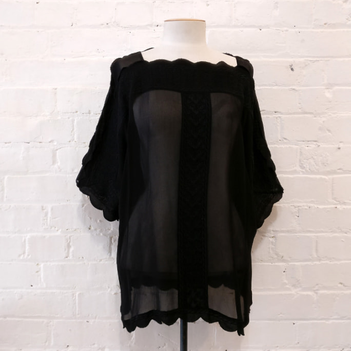Oversized embroidered sheer top with scalloped edging.