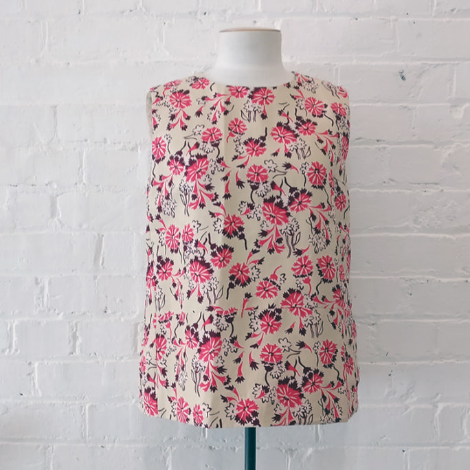 Sleeveless floral top.