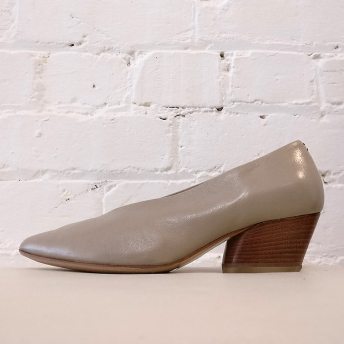Slip-on shoe with stacked wood heel.