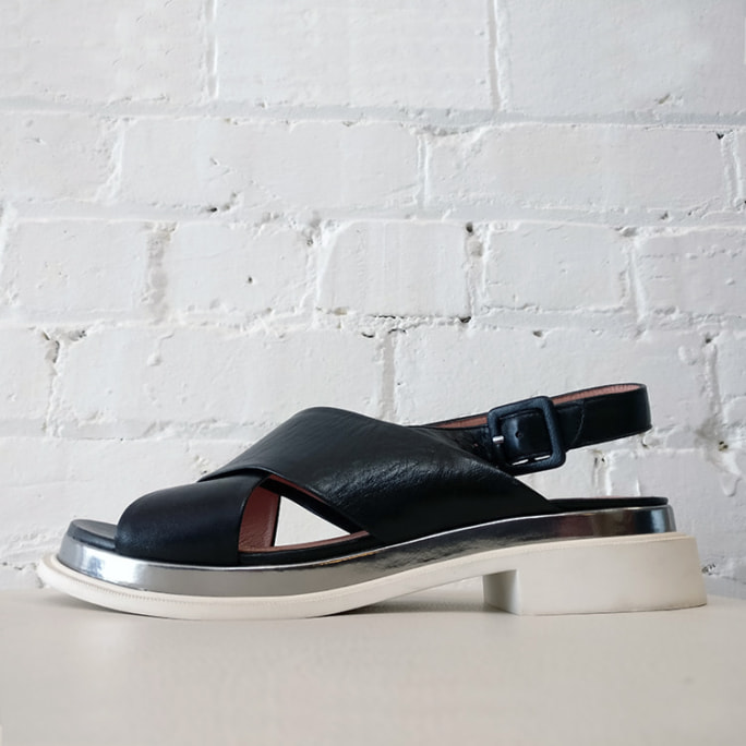 Cross-over sandal with metallic inlay detail.