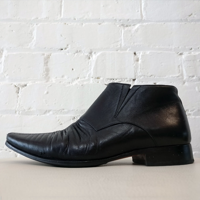 Slip-on shoe with rouged leather detailing.