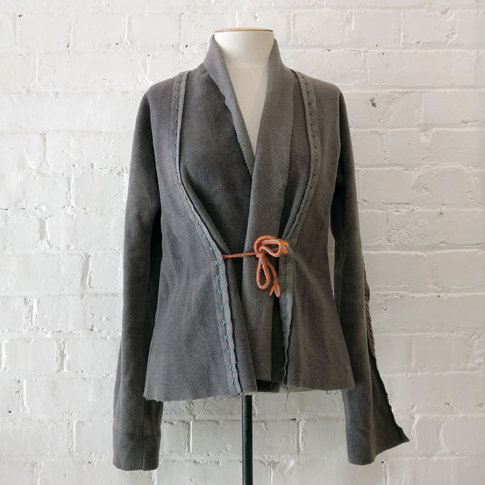Hand-embroidered 100% wool jacket, deconstructed.