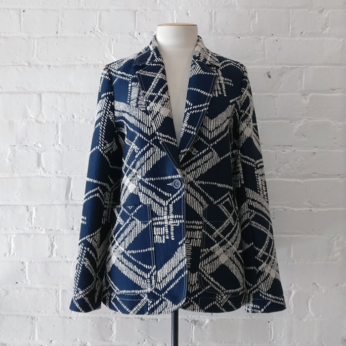 Lined jacket with patch pockets.