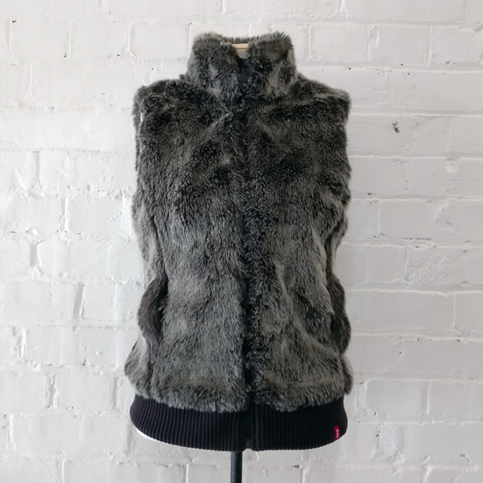 Faux fur vest with pockets, lined.