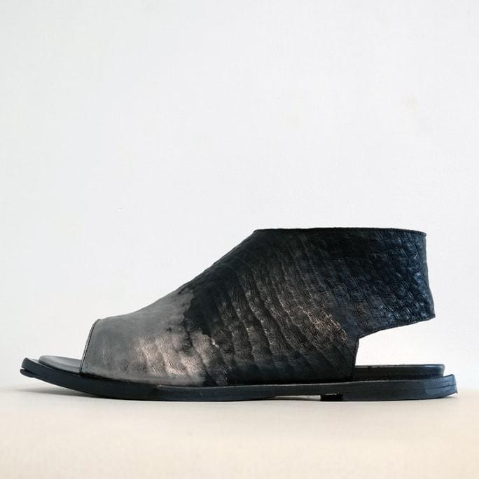 Open-toed zip sandal.