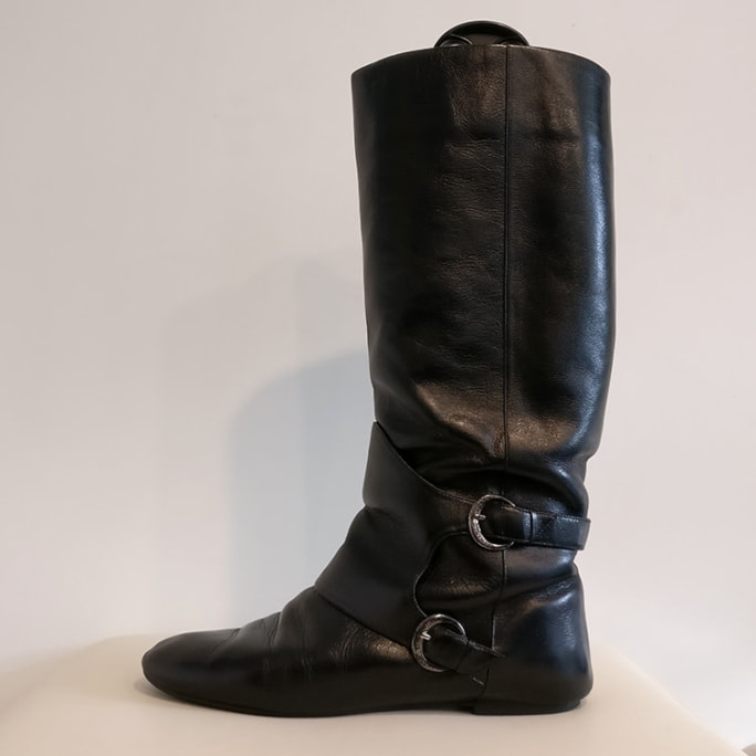 Black leather military style boot.