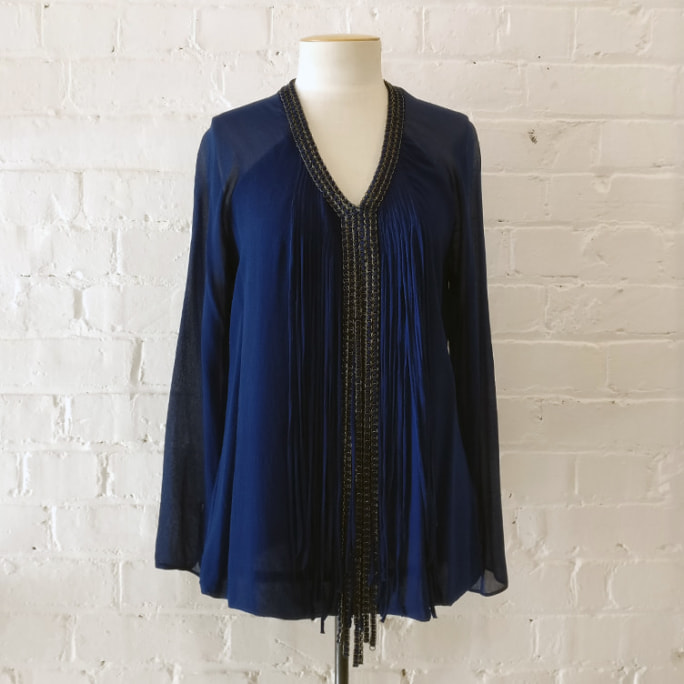 Silk top with metal and fringe front.