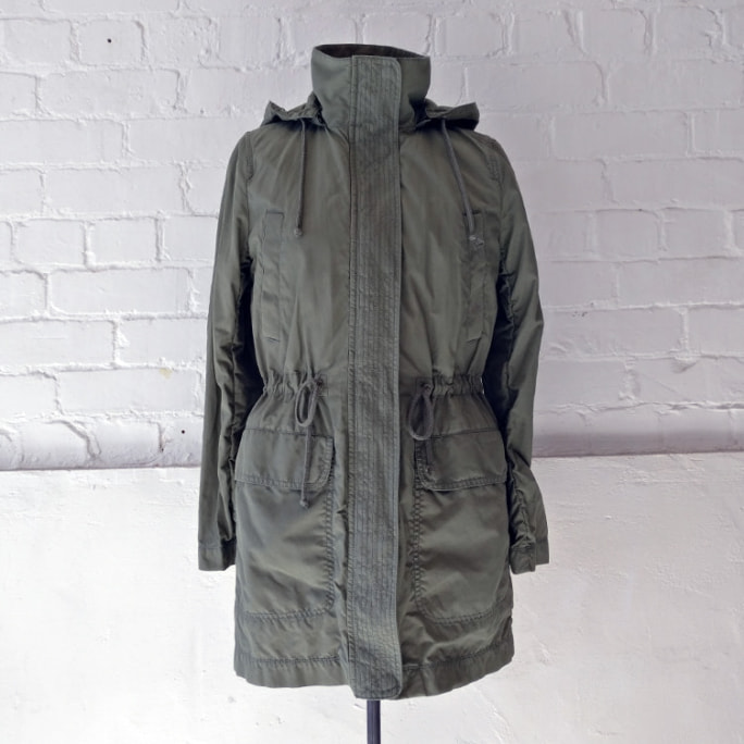 Utility jacket with zip-off hood and removable padded lining.