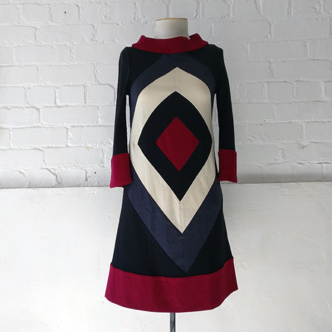 60s-style section wool dress with bell sleeves and high collar, unlined.