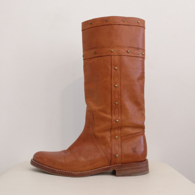 Tall tan leather boot with contrast stitching.