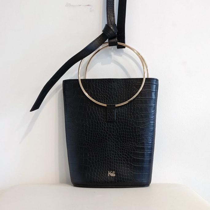 Beecroft bucket bag with metal hoop handles and shoulder strap.