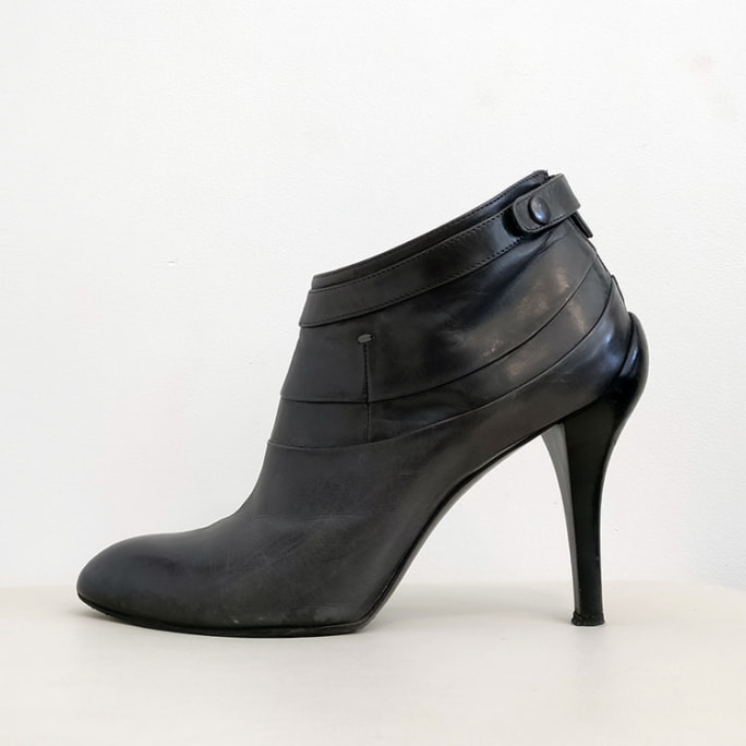 High heeled shoe boot.