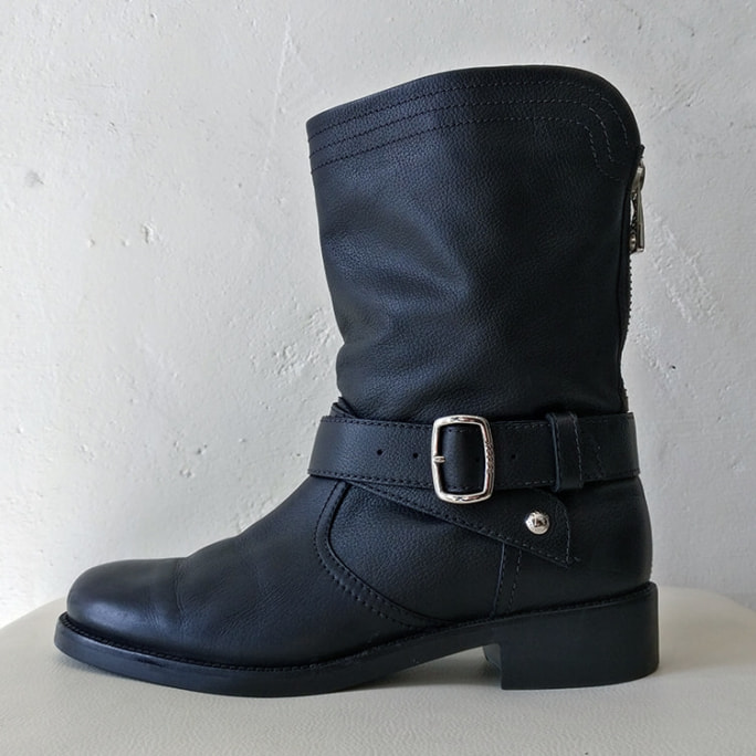 Mid-calf grained leather biker boot with box and dust bag.