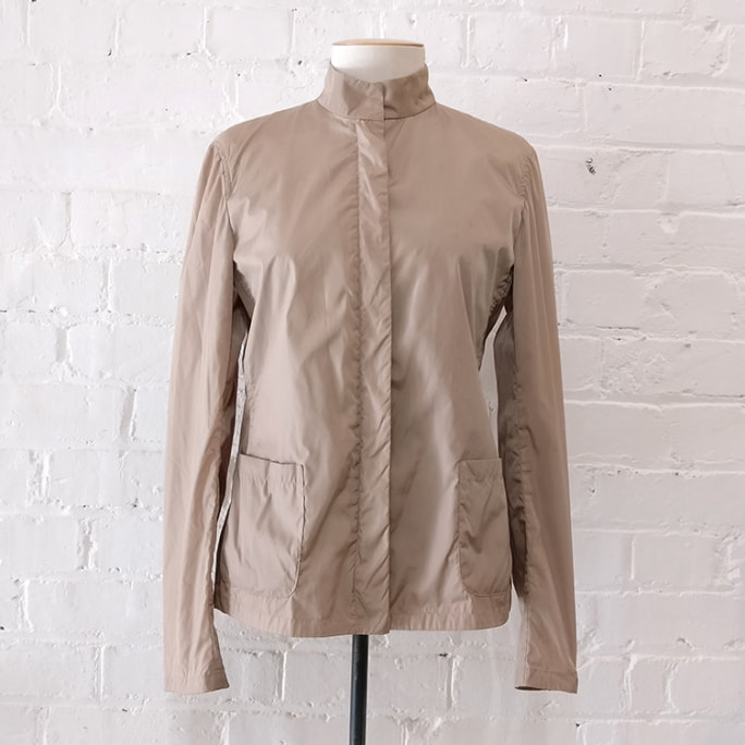 Light showerproof zip-up jacket with patch pockets.