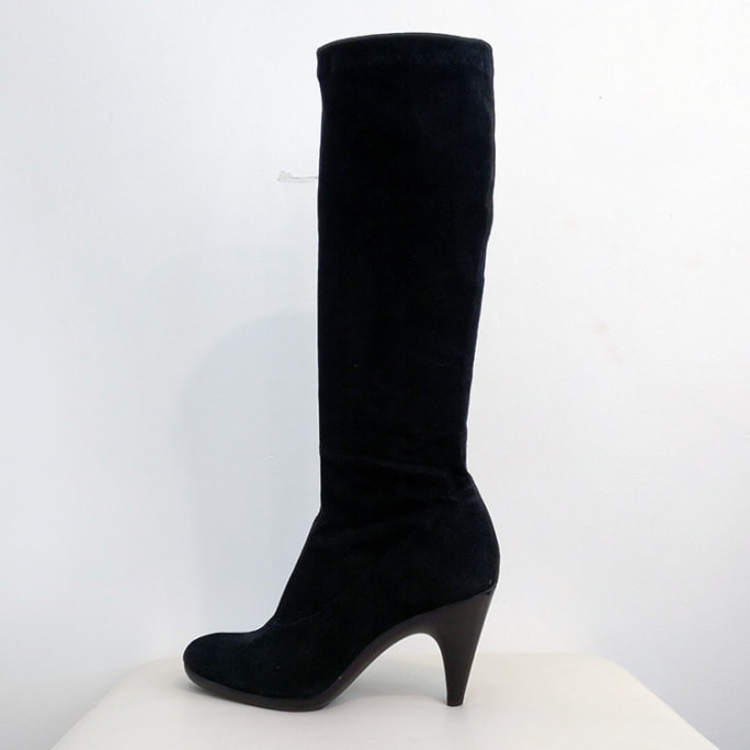 Tall suede boot with molded sole.