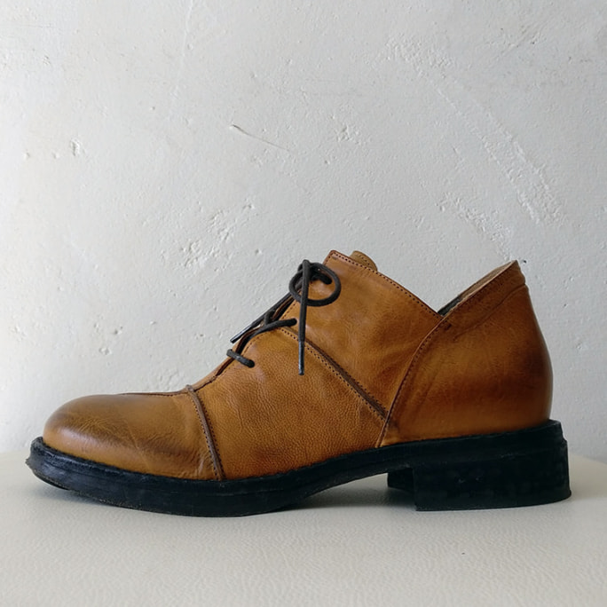 Handmade lace-up shoes.