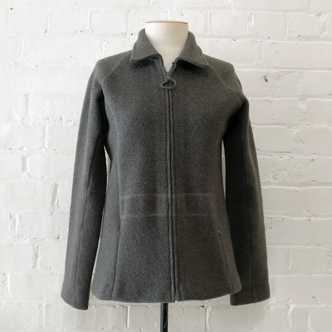 Zip-up unlined jacket.