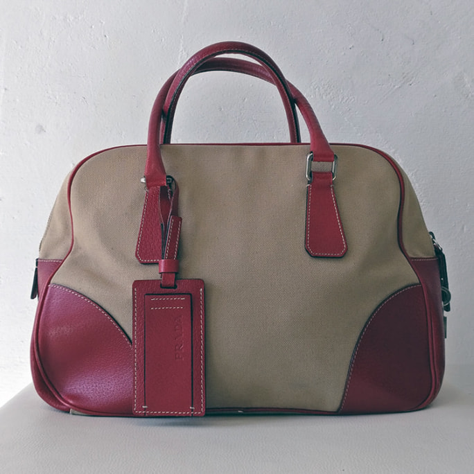 Leather and canvas hand bag with gorgeous crimson lining.