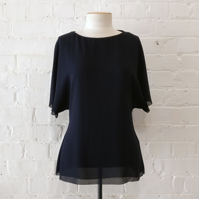 Dark blue silky bat-sleeve top.