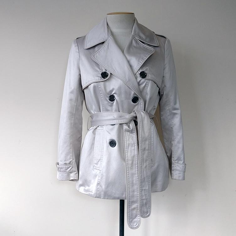 Lined mini trench with pockets and belt.