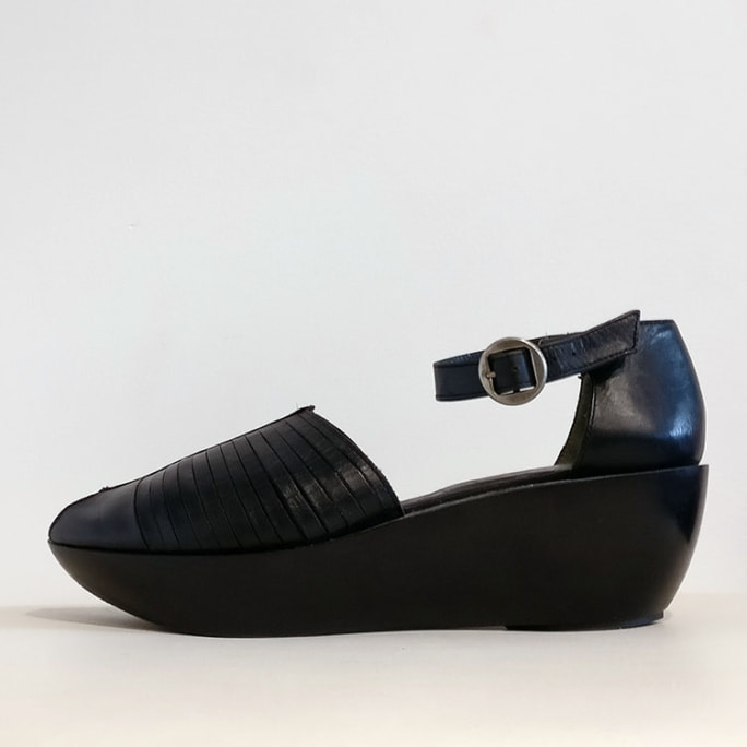 Peep-toe sandal with molded sole and ankle strap.