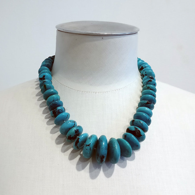 Mexican turquoise neckpiece with heavy circular discs.