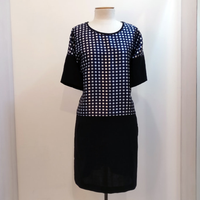 Spellcheck tunic-style dress with pockets.