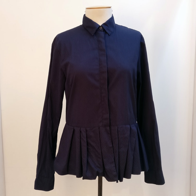 Shirt with peplum frill and subtle print.